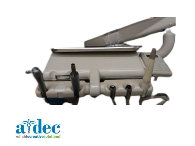 A-dec side delivery system with motor and scaler